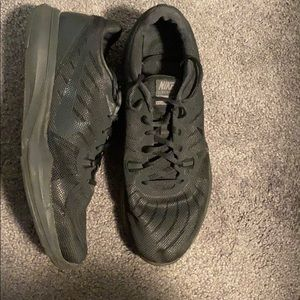 Women's all black Nike running shoes